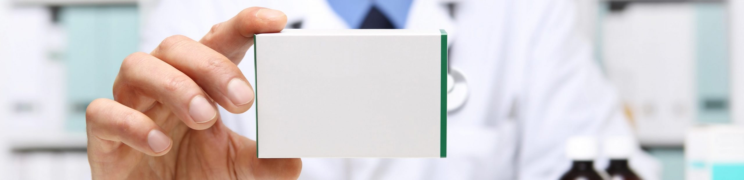 Spectrum Packaging Male Doctor Holding Up Medical Packaging Box