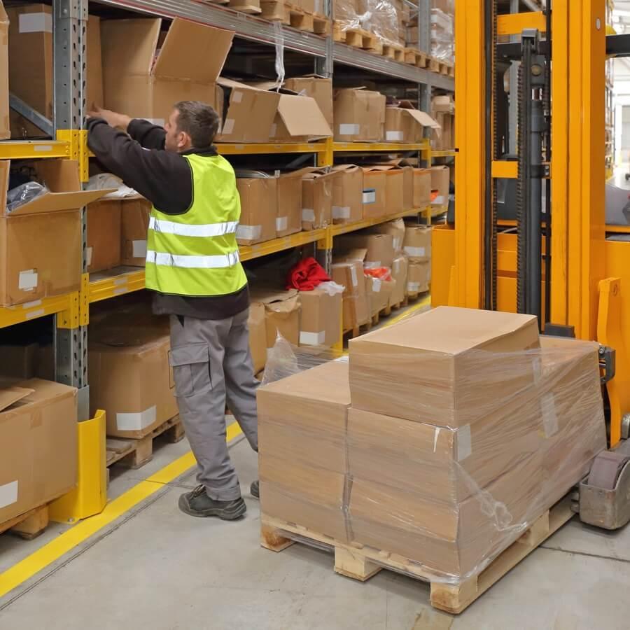 Spectrum Packaging Man Restocking Warehouse Shelf Thumbnail