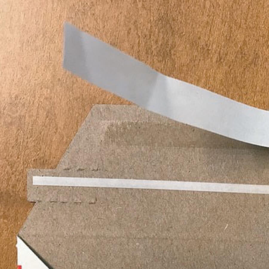 Spectrum Packaging Tape Application on Back of Corrugated Mailer Thumbnail